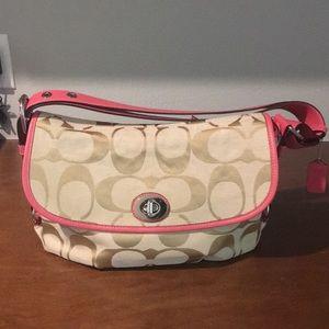 Coach woman pink accent purse